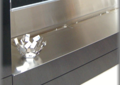 Détail meuble tv : cheminée au bio éthanol
